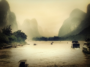 Guilin river men weave through the mountains